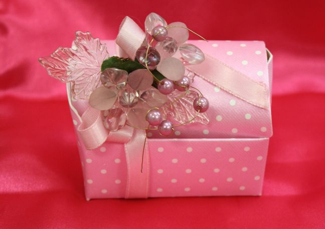 Pink Polka Dot Chest Favor Box Our boxes are decorated with the finest quality ribbons and flowers You can customize the boxes to your color scheme Our boxes are filled with 5 Jordan almonds Chocolate or candy can substitute the Jordan almonds for an additional fee They are a great addition to seating plates, seating cards or simply party favors  Ribbons, flowers and boxes come in various colours.   #favor #boxes #wedding #baptism #shower #favorboxes  #bonbonniere #pink