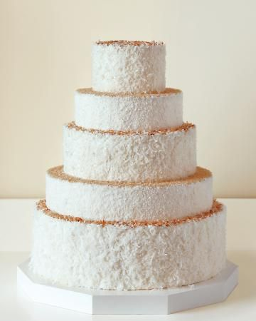Coconut cake with mango buttercream filling and iced with vanilla buttercream then topped with toasted coconut? A delish and beautiful coconut lovers dream #Wedding cake!