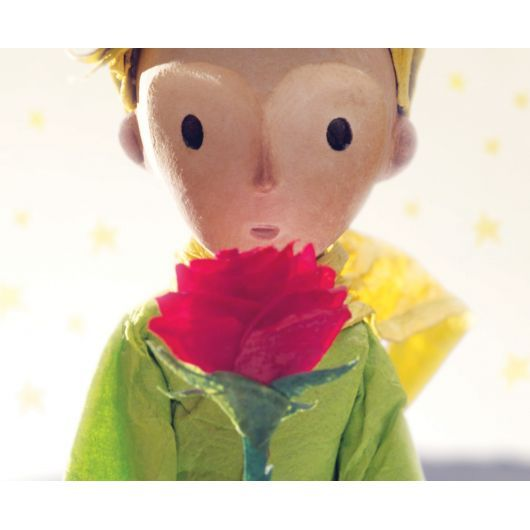 One hundred sturdy cardboard puzzle pieces show a moment of friendship between The Little Prince and The Rose.