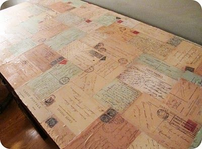 decoupage desk... It would be awesome to use photo copies of real envelopes.  Only those of us who have actually written copious letters could do that!  ;)  @Penelope Cream would like this, I think!