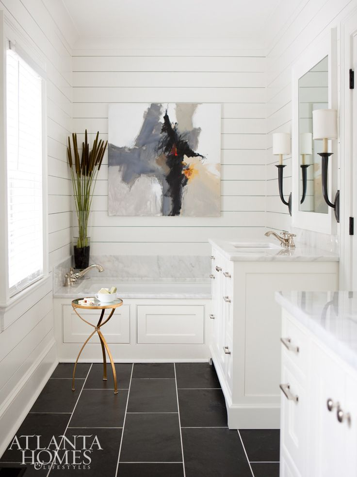 Builders Floor Covering & Tile installed the sleek Black Blizzard slate flooring in the otherwise neutral master bathroom.
