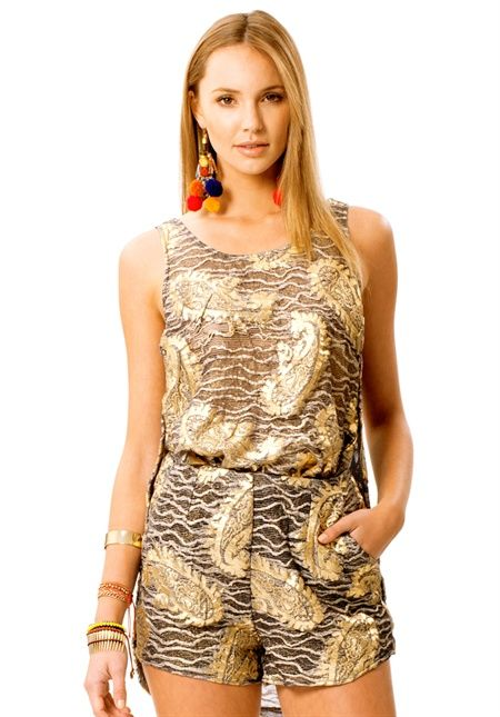 TAKE TO THE SKY TOP is a foil print lace tank featuring scoop back and uneven hemline. Made from a textured foil print lace this top is lightweight and beautiful to wear. Fabric: 60% Cotton 35% Nylon & 5% Spandex #NicheFashion