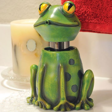 "Frog Soap Spitter.      Adorable handmade froggy soap dispenser is perfect addition to a child's bathroom. Hand washing is fun when froggy spits your soap! Polyresin. 3 ¼""W x 7""H."