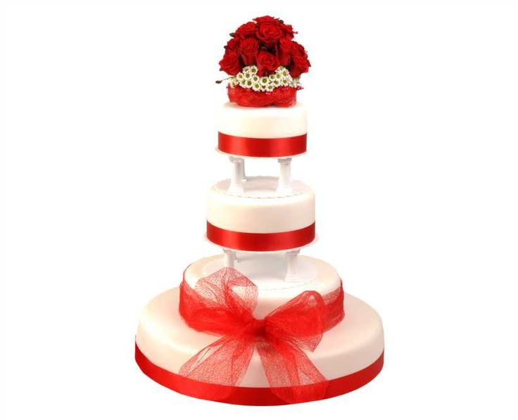 Svatební dort 42 Čtyřpatrový svatební dort, o rozměrech 18 cm, 24 cm, 32 cm a 52 cm, obalen fondánem, dozdoben saténovými stuhami a živými květy