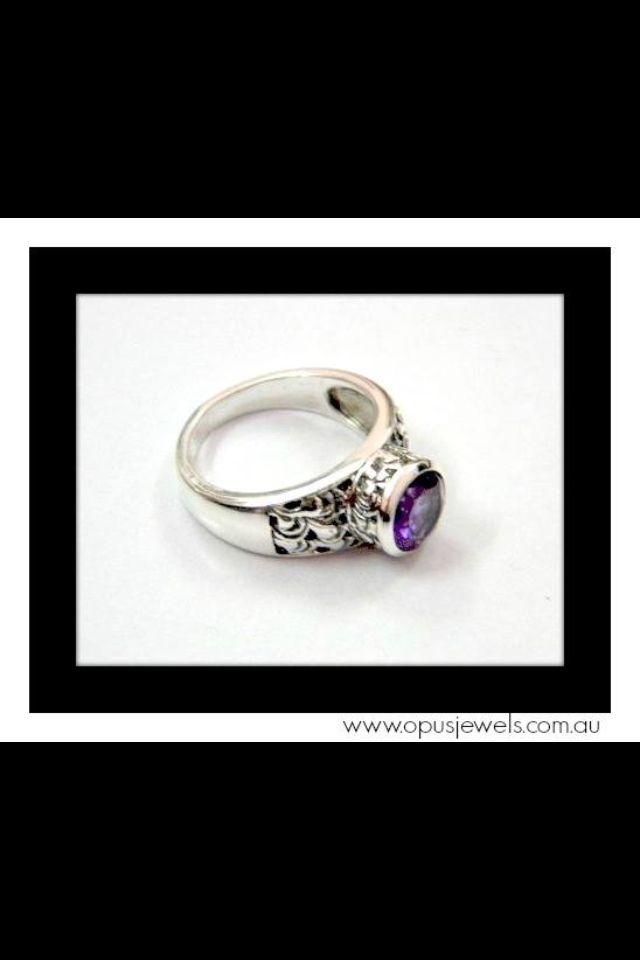 Stunning elegance!  Raised, round bezel set Amethyst ring enhanced with paisley patterned feature.  www.opusjewels.com.au