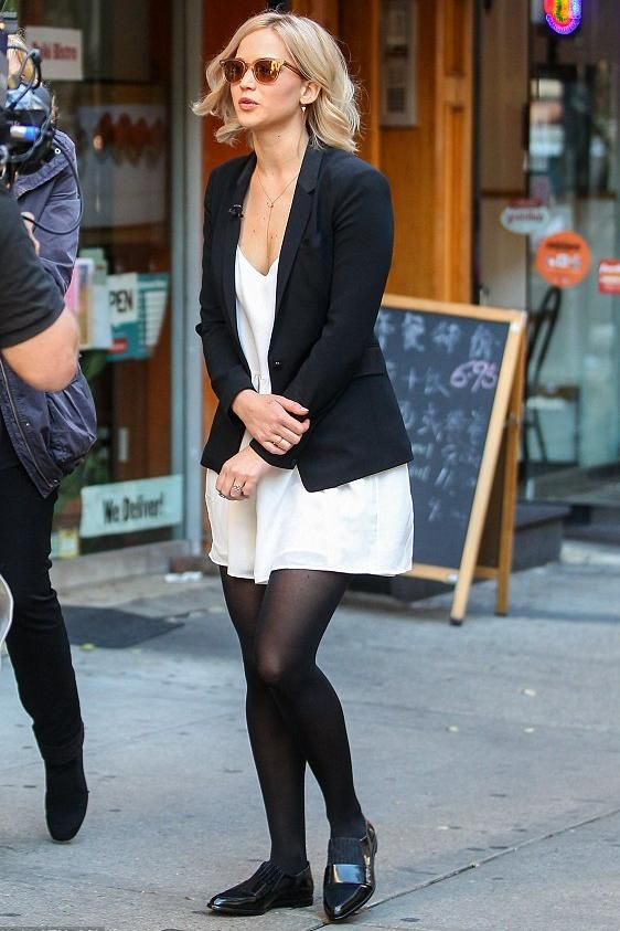Jennifer Lawrence wearing Oliver Peoples Masek Sunglasses, Anine Bing Silk Slip Dress, Selin Kent Eva Ring and Logan Hollowell Diamond Constellation Ring