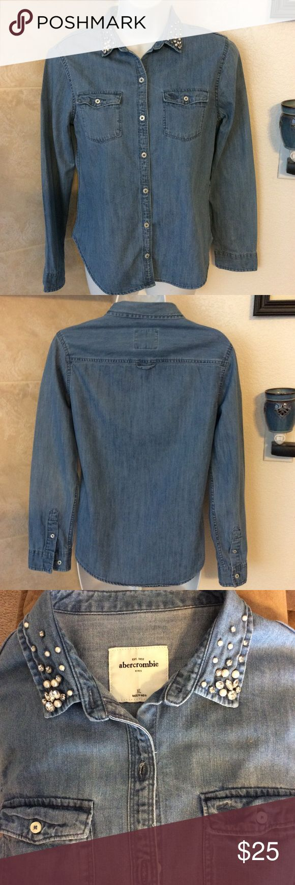 Girls Abercrombie Kids embellished jean shirt Size Girls  XL.  can fit ladies XS  or S, as well. Beautiful shirt.  Please ask questions.  Buttoned and lying flat measured 17 inches from arm pit to arm pit. Excellent condition.  Is the deeper blue color Pic no.1 is stock photo. abercrombie kids Shirts & Tops