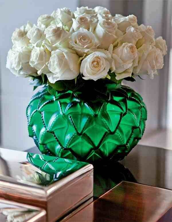 White roses in a pretty green vase