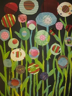 """We have tons of pretty printed papers..... Make a library flower garden. Book covers could be inserted as """"blooms."""""""
