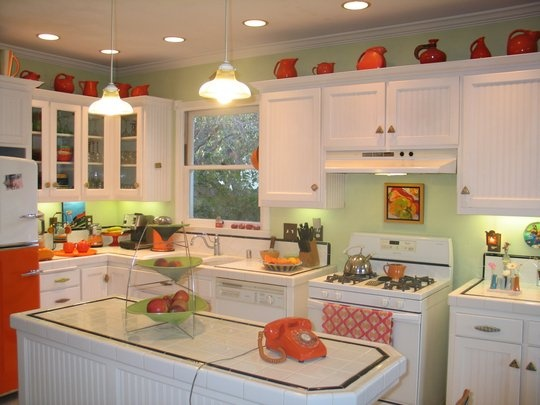"Such a sweet, homey kitchen. I like the Fiestaware on top of the cabinets. Tina's ""Morning Pick Me Up"" Kitchen 