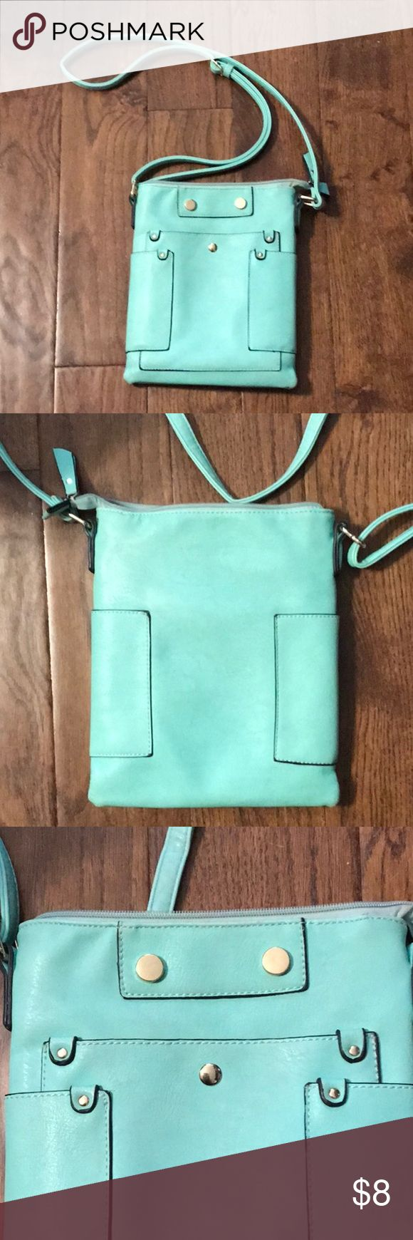 Teal purse Super cute! The inside looks great, only wear I could find was on the bottom of the purse, see pictures. Has a magnetic pocket on the front great for holding your phone miss unique Bags Crossbody Bags