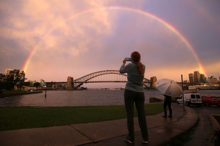 Sydney, Australia       A rainbow forms over the Sydney Harbour Bridge on June 17.