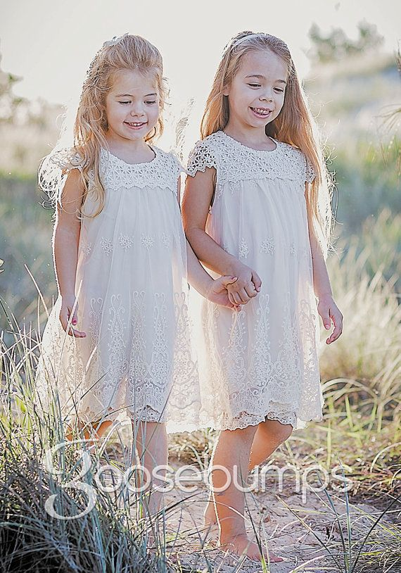 """If you love the """"Vintage Look"""" you will certainly love this beautiful Vintage White/Off Cream coloured Macy girls lace dresses. The detail on this dress is exquisite.NEW IMPROVED DESIGN, Better quality lining not see through.This dress is fully lined with embroidered lace trim has a delicate embroidered lace overlay to give your sweet girl that """"I am special"""" feeling. You will find beautiful crocheted lace at the neckline, finished with a sweet cap sleeve. The back is secured with a single…"""