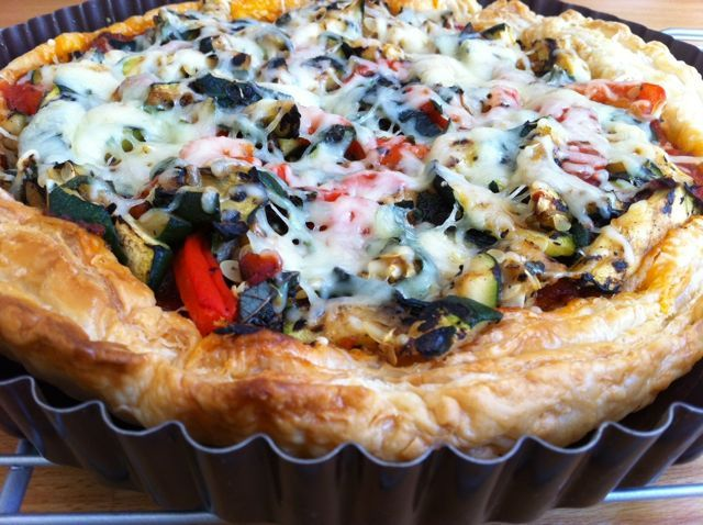 tarte with onion zucchini garlic thyme roasted tomatoes emmentaler and parmesean cheese.  BUTTER that tart pan and get a crisp crust!  Pate brisee or perhaps chaux pastry?