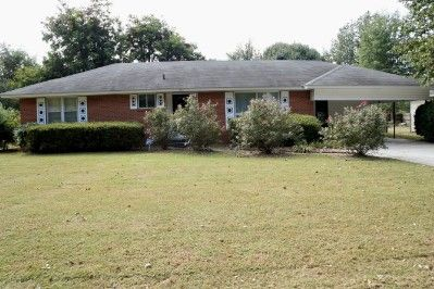 Beautiful Brick home. This home was built in 1959 and has always been owned by the same family. 2057 Sq. Ft., with 3 Bedrooms, 2 Baths, Hardwood floors under carpet. Large den with gas fireplace. Updated Central Heat and Air. Large screened and covered patio. 24 x 12 Storage building with overhead door, fenced yard. Very well maintained property. Lot 102x144. Mls1520. Listing Agent Tina Privett in Kennett MO