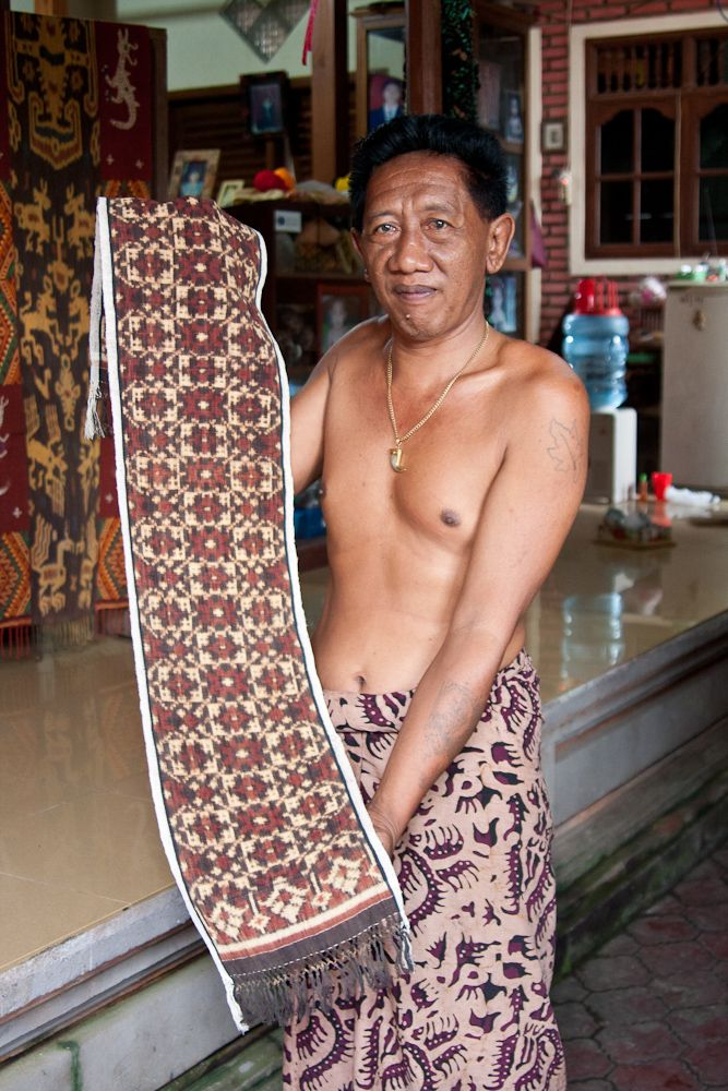 A weaver displays his work -- a traditional double ikat, in Tenganan, Bali.