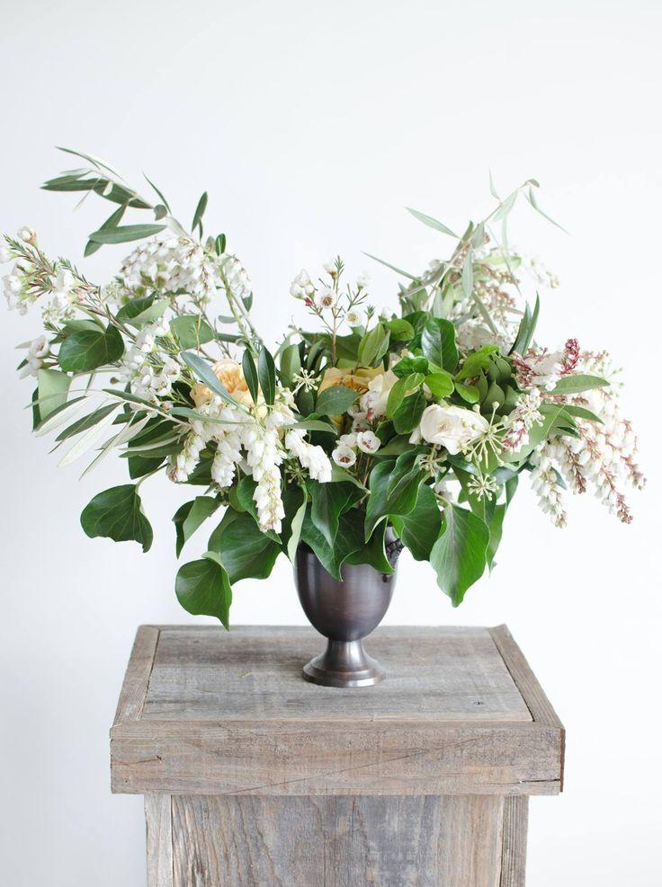 Fun little arrangement in a petite bronze urn. | by Gavita Flora. #white #wedding #flowers