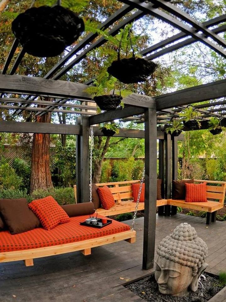 Zen Backyard  The Buddha is not only the focal point of this space, it's also designer Jamie Durie's source of  inspiration for this relaxing, Asian-themed room. A hanging daybed provides a place for the family  to lounge, while a nearby bench adds ample seating for visitors.
