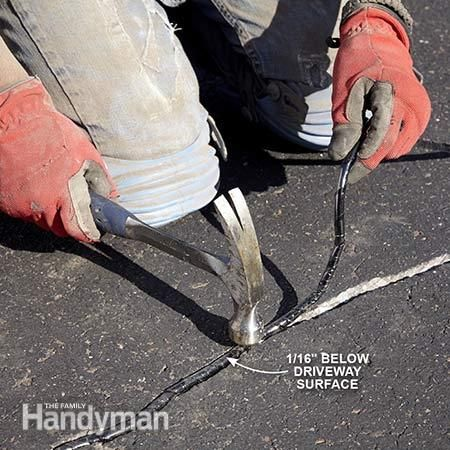 Compress the filler - Asphalt Patching and Crack Repair: http://www.familyhandyman.com/masonry/asphalt-patching-and-crack-repair/view-all