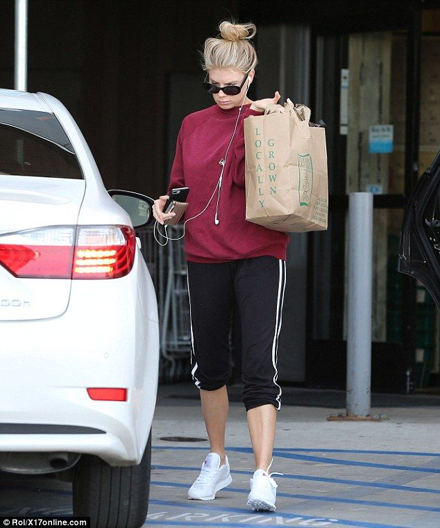 Focused:The 24-year-old covered up in Adidas bottoms with a baggy sweater during her solo...