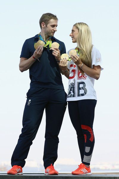 Team GB cyclists Laura Trott and Jason Kenny pose with their gold medals at Adidas House on August 17, 2016 in Rio de Janeiro, Brazil.