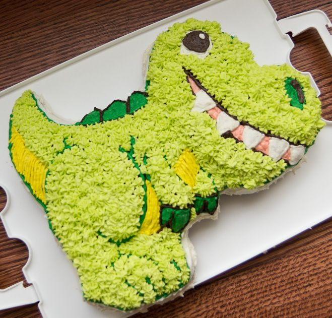 Dinosaur cake. I bought this Wilton cake pan to make Evan's cake too.