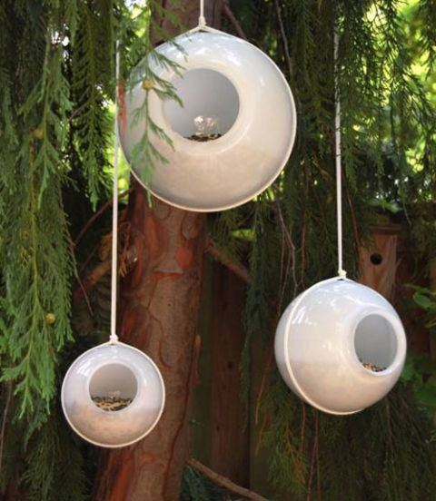 The floating orbs (made with inexpensive glass lampshades!) will intrigue birds and humans alike in a backyard display.  Get the tutorial.