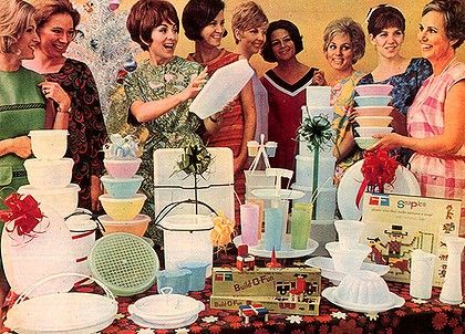 Ladies surrounding the display table at a Tupperware Party.