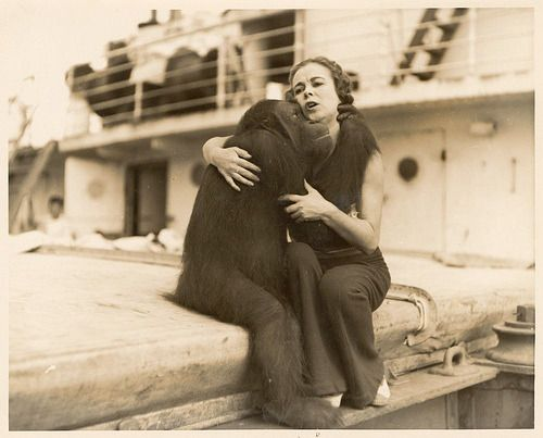 Date unknown  A woman consoles a orangutan on a cruise ship.