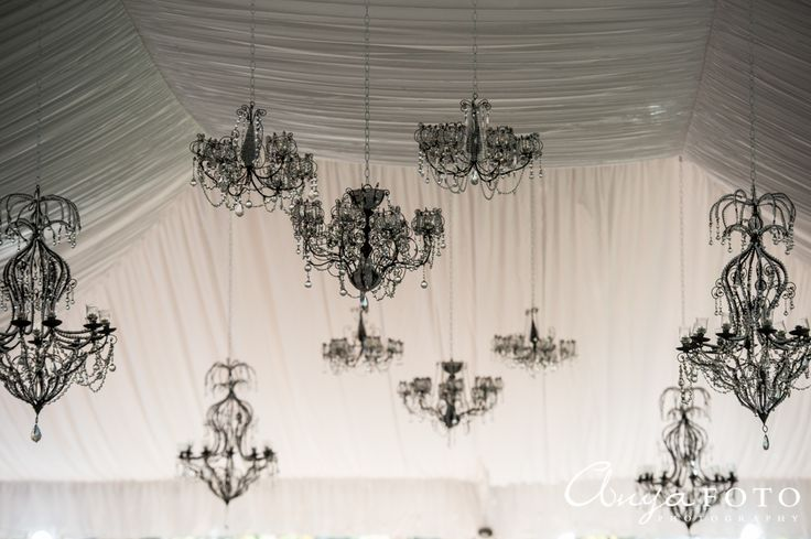 Chandelier decor ideal for wedding venues with  draped white high ceilings. | Aramat Events // Images by AnyaFoto Photography // www.anyafoto.com