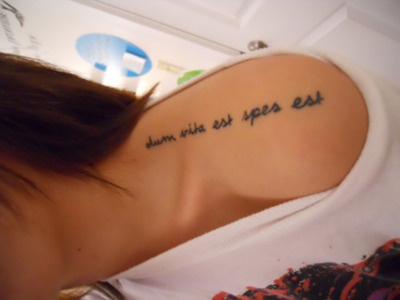 """It is in Latin and means """"while there is life there is hope"""""""
