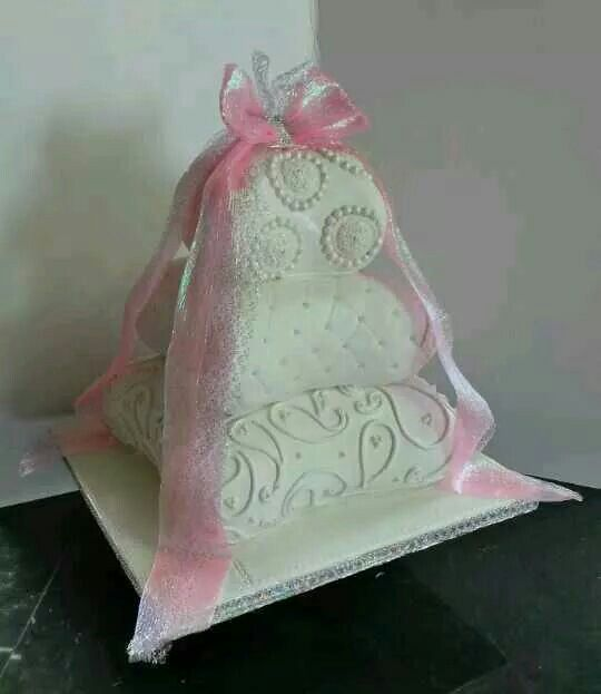 Pretty pink ribbon pillow wedding cake