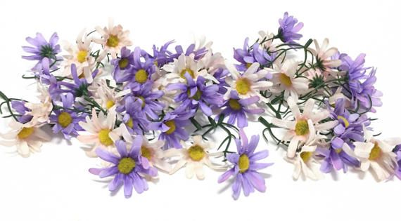 Youll receive one lot of artificial pink and lavender purple Daisy flowers on short, flexible plastic stems. There are approximately 50 flowers on the stems, and the flowers measure approximately 2 inches in diameter. The stems on which the flowers are attached range in length from 2 inches to about 2.25 inches. These bunches are perfect for crafting flower crowns, halos, woodland crowns, and wedding crowns. These artificial wildflowers are new and have been removed from the longer stems…