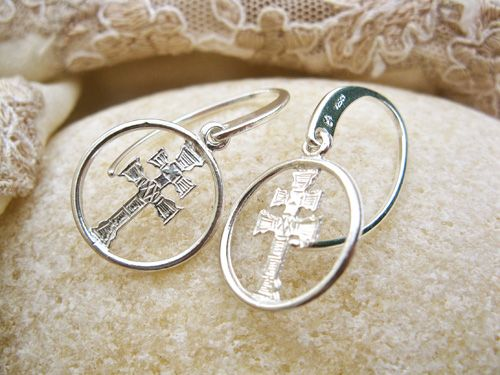 Caravaca Cross earrings - . . a lovely gift of faith. These silver earrings feature the cross of Caravaca - believed to invoke a sense of tranquility, faith and acceptance. The two-armed cross has its origins in the town of Caravaca, central Spain where, during the early 13th Century, according to legend, a miracle took place. The Caravaca Cross has since been recognised as a symbol of protection and faith.