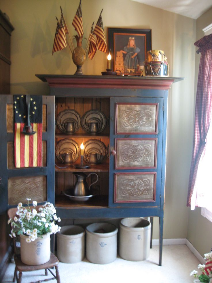The Patriot Homeplace, don't like the color scheme but love the punched tin pie safe. #diningroom
