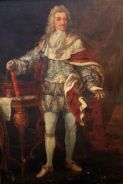 Re Vittorio Amedeo II che nel 1728 a seguito della sua ascesa al trono ordina all'ing.Conte di Exelles,Ignazio Bertola da Roveda la progettazione e l'erezione di una nuova Cittadella in Alessandria.Ciò si desume facilmente dal quadro in quanto è ritratta una mappa con il progetto di una cittadella da cui emerge in chiaro la parola NDRIA.(l'Ufficio Conservazione beni mobili dell Reggia Venaria a Torino che,esaminata la foto, conferma quanto sopra)