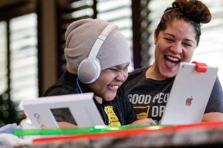 Laten Holeman, 10, who was diagnosed with a rare autoimmune disorder three years ago, laughs with his mother, Valhalla Holeman, as she home schools him Wednesday, Dec. 16, 2015, in Missouri City. Without drugs, Laten's disorder leaves him with cracked and broken skin all over his body, making him susceptible to non-stop staph infections. In October, his parents found out that their insurance, Blue Cross Blue Shield, wouldn't be offering their PPO anymore, forcing them to scramble and pay…