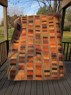 Great fall quilt!!  Looks to be made form homespun fabrics.