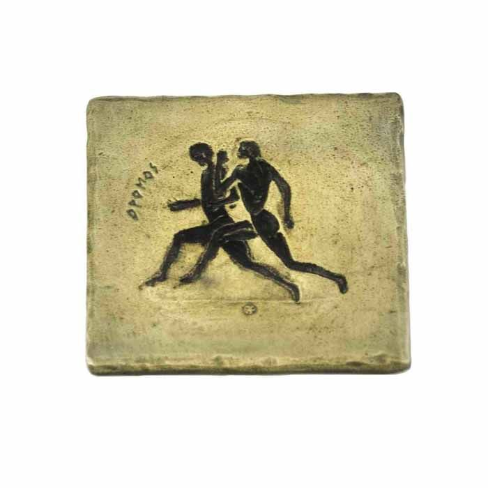 Stadion race, was a sport feature of Ancient Olympics.   Drawing engraved and casted in bronze to be used as a coaster and as a paperweight for the retention of documents.  Dimensions: 9.5 cm x 9.5 cm  Bronze
