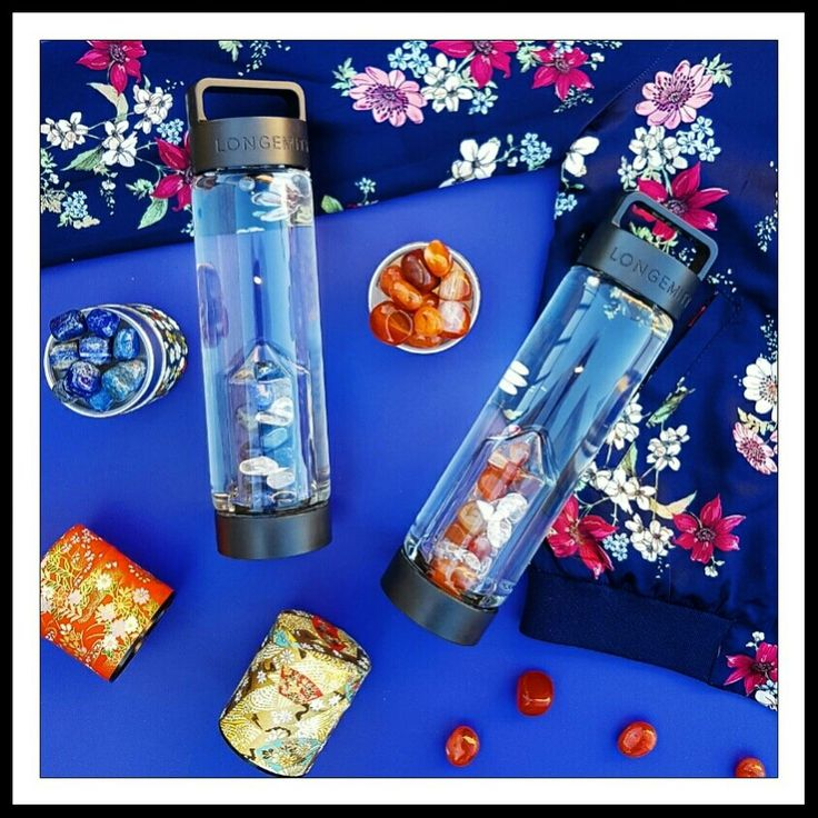 Longemity luxe water bottles filled to the brim with exquisite crystals.