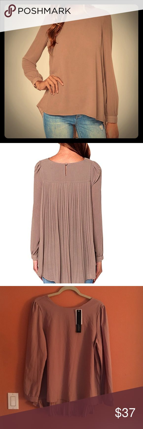 Chiffon blouse with high neckline and pleated back Material:Chiffon  Type:Blouse  Color:Khaki New Lady's Chiffon Loose Chiffon Casual Cool hi lo Blouse.  tag sizes are Asian sizes. US size 10/12 L/XL the fabric content is not given besides chiffon. Its a really lovely fabric that is a very soft chiffon. Its not see through. 🚫no trades🚫 ask questions Tops Blouses