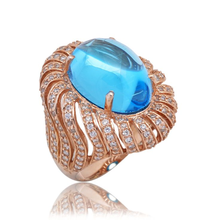 Swiss Blue Topaz setted with diamonds in 92.5 sterling silver.stock available