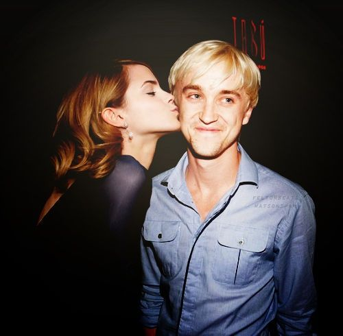 Emma Watson (Hermoine) and Tom Felton (Draco) behind the scenes of Harry Potter.