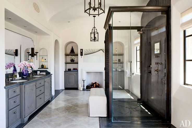 Gisele Bündchen and Tom Brady's Los Angeles Home Installed in the master bath are lanterns by Dennis & Leen, Kallista sinks, and turquin-blue-marble counters from Compas Architectural Stone, which also designed the sink and shower fittings; the artwork above the fireplace is a photograph of Gillette Stadium (where the Patriots play) by Jon Coulthard.