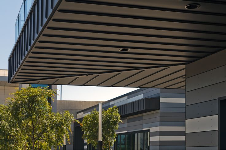 black painted steel soffit with grey black and white facade
