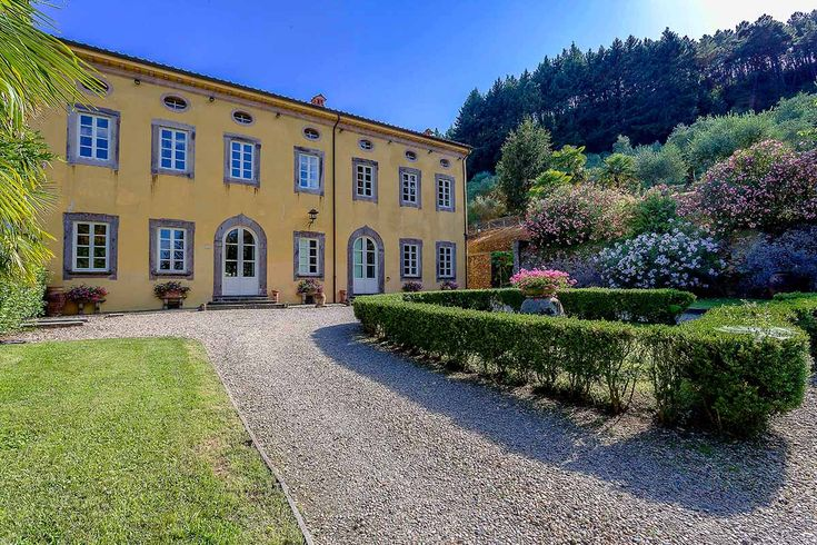 Villa Controni, nestled below Monte Pisano on the southern outskirts of Lucca, is an historic 19th century Lucchese villa set on a stunning estate of hill terraced olive groves, elegant Italian gardens and pine forest hilltops with castle ruins.