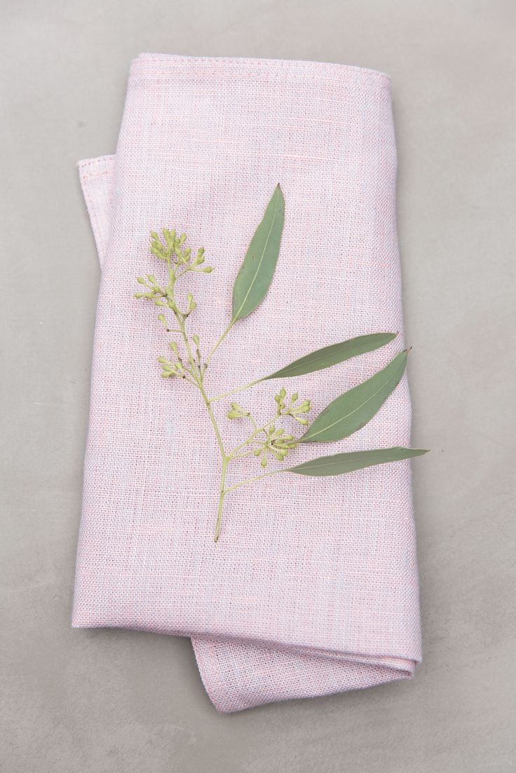 Kallio Napkin | Made of linen, Kallio (Rock) napkin brings a festive feeling to your table. You can fold this napkin in impressive ways or hide a warm bun inside it. Available in pink, grey and blue.