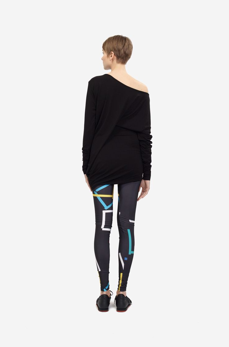 LEGGINGS COLOR PRINT Shorthaired model wearing a black asymentric mini dress and a black leggings with an original colored print. Design: Lucie Kutálková / LEEDA