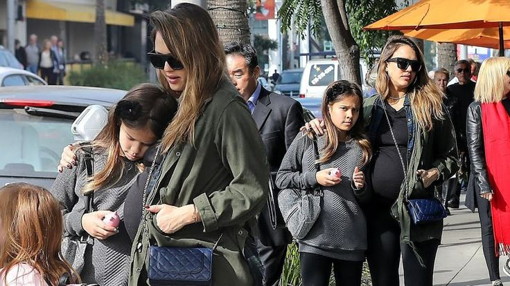 Pregnant Jessica Alba shows off bump in clinging top and leggings as she...