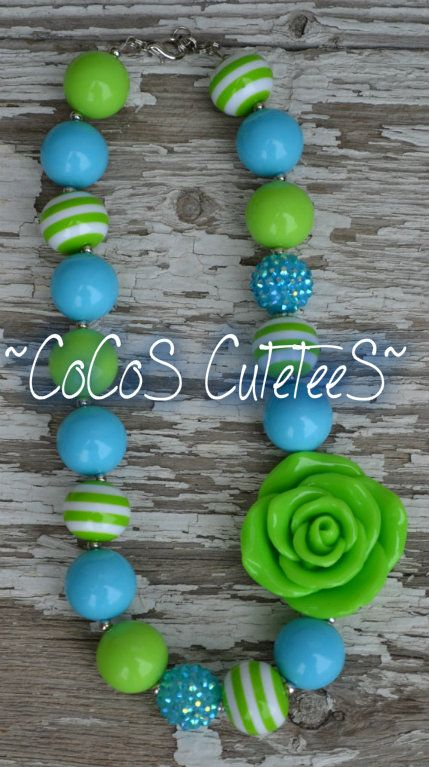 Order at www.facebook.com/cocoscutetees Teal/green stripe chunky bead gumball bead necklace w/ flower pendant